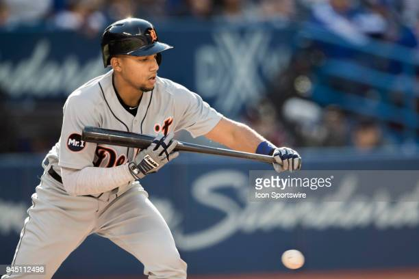 Detroit Tigers Infielder Dixon Machado try's to lay down a bunt during the regular season MLB game between the Detroit Tigers and the Toronto Blue...