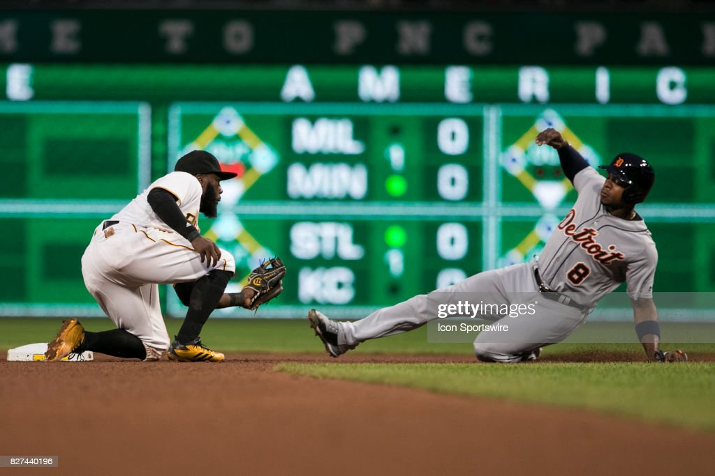 Detroit Tigers Left field Justin Upton (8) is caught stealing and tagged out by Pittsburgh Pirates Infield Josh Harrison (5) during the Major League Baseball game between the San Francisco Giants and the Pittsburgh Pirates on August 7, 2017, at PNC Park in Pittsburgh Pa.