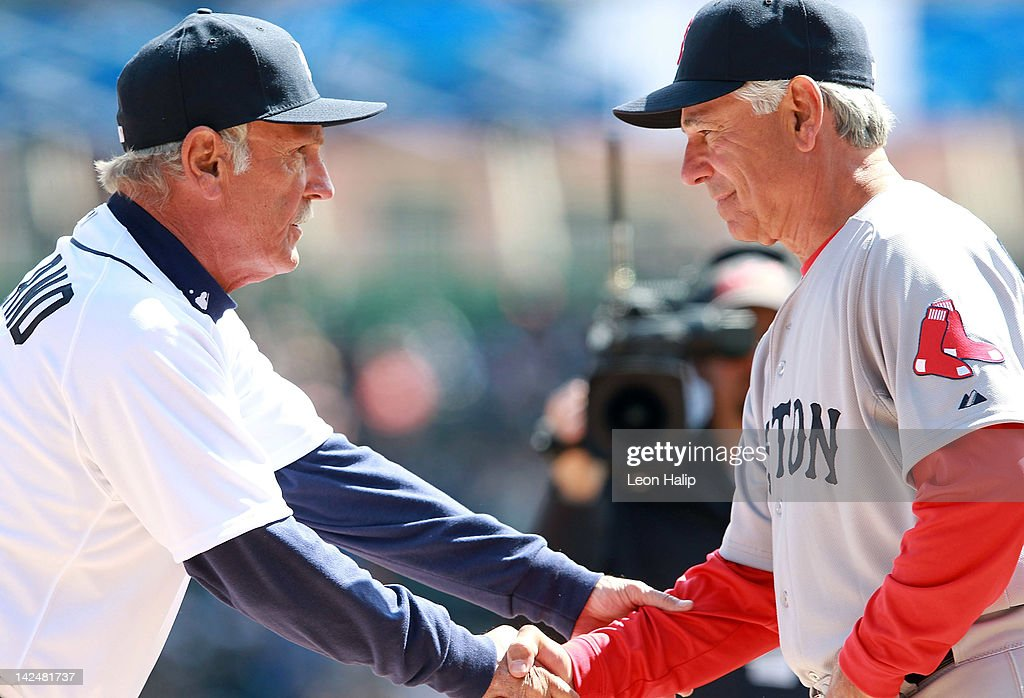 Detroit Tigers manager Jim Leyland #10 and Boston Red Sox Manager Bobby Valentine #25 exchange handshakes at home plate prior to the start of the game against the Detroit Tigers at Comerica Park on April 5, 2012 in Detroit, Michigan. The Tigers defeated the Red Sox 3-2.