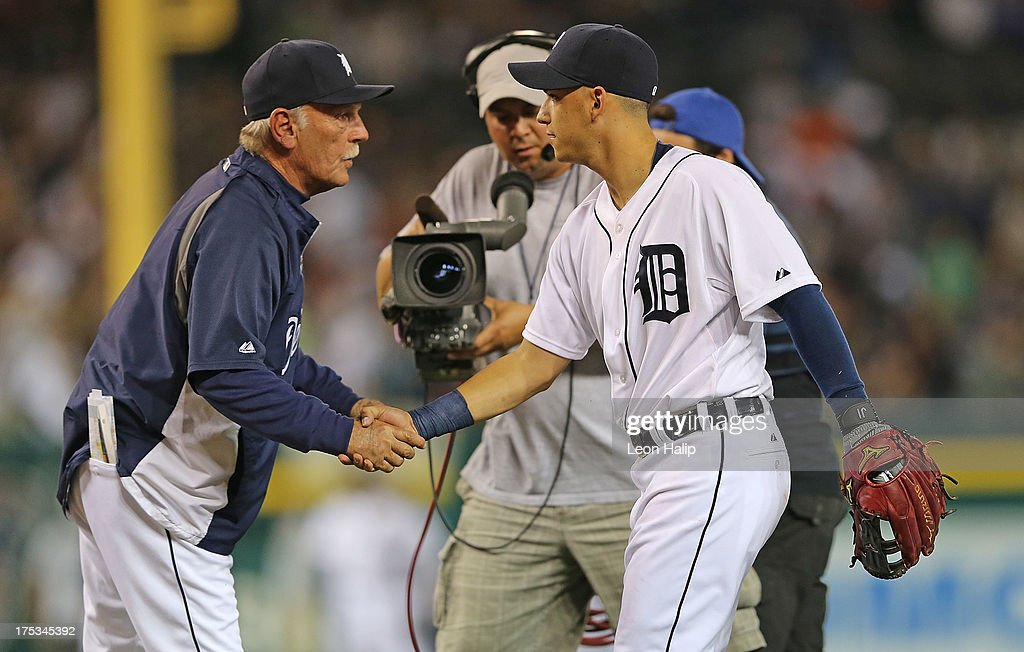 Detroit Tigers manager <a gi-track='captionPersonalityLinkClicked' href=/galleries/search?phrase=Jim+Leyland&family=editorial&specificpeople=239038 ng-click='$event.stopPropagation()'>Jim Leyland</a> #10 celebrates a win over the Chicago White Sox with newly acquired infielder Jose Iglesias #1 during the game at Comerica Park on August 2, 2013 in Detroit, Michigan. The Tigers defeated the White Sox 2-1.