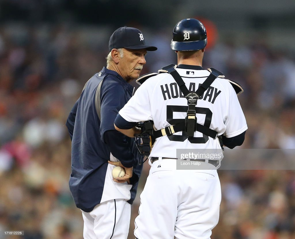Detroit Tigers manager Jim Leyland #10 talks with catcher Bryan Holaday #50 during a pitching change in the fifth inning of the game against the Los Angeles Angels of Anaheim at Comerica Park on June 25, 2013 in Detroit, Michigan.