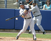 Detroit Tigers outfielder Brent Clevlin hits the ball up the middle for a base hit in a spring training game against the New York Yankees on Thursday...