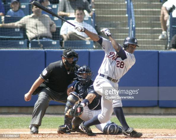 Detroit Tigers outfielder Curtis Granderson hits a ground ball towards second base against the New York Yankees in a spring training game on Thursday...
