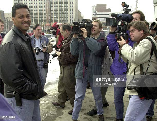 Detroit Tigers outfielder Juan Gonzalez is surrounded by photographers in Detroit Michigan 09 February 2000 It is reported that Gonzalez the American...