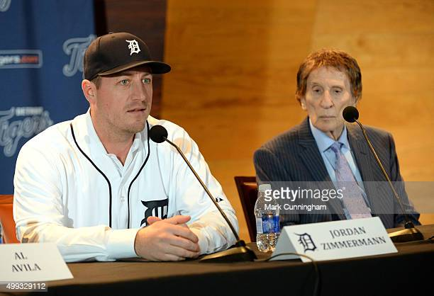 Detroit Tigers owner Mike Ilitch looks on as newest Tigers pitcher Jordan Zimmermann talks to the media during the press conference to announce his...