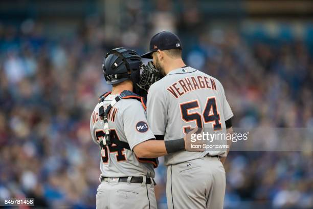 Detroit Tigers Pitcher Drew VerHagen discusses strategy and gives support to Detroit Tigers Pitcher Drew VerHagen during the regular season MLB game...