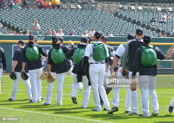 Detroit Tigers pitchers walk to the bullpen wearing turtle backpacks prior to the game against the Chicago White Sox at Comerica Park on September 14...