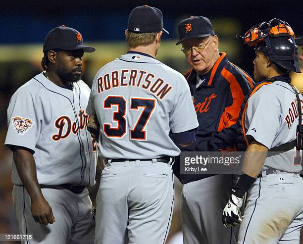 Detroit Tigers pitching coach Bob Cluck talks with Dmitri Young Nate Robertson and catcher Ivan Rodriguez during 84 victory over the Los Angeles...