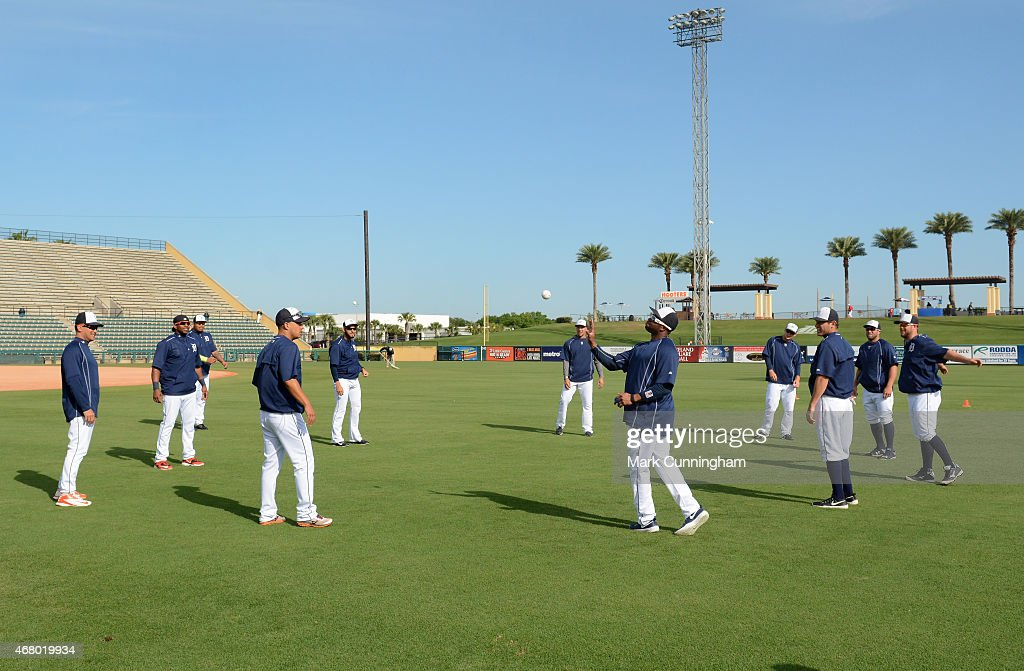 Detroit Tigers players warmup by tossing a baseball around prior to the Spring Training game against the St Louis Cardinals at Joker Marchant Stadium...