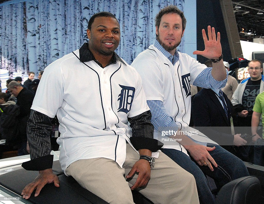 Detroit Tigers Rajal Davis (L) and <a gi-track='captionPersonalityLinkClicked' href=/galleries/search?phrase=Joe+Nathan&family=editorial&specificpeople=215405 ng-click='$event.stopPropagation()'>Joe Nathan</a> attend the Detroit Tigers winter caravan tour stop at the North American International Auto Show at Cobo Hall on January 24, 2014 in Detroit, Michigan.