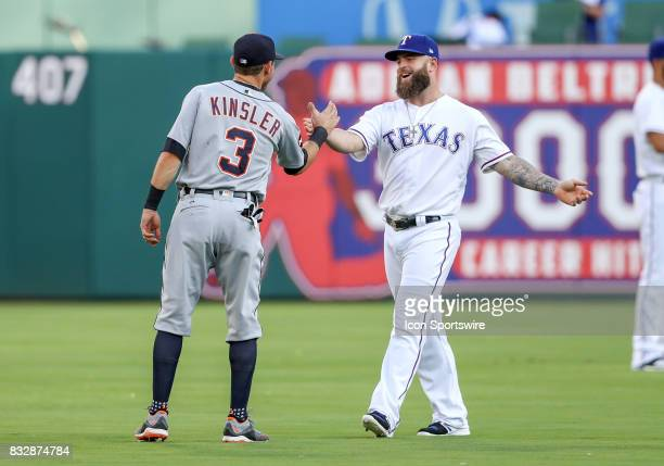 Detroit Tigers second baseman Ian Kinsler and Rangers Mike Napoli greet each other before the MLB game between the Detroit Tigers and Texas Rangers...