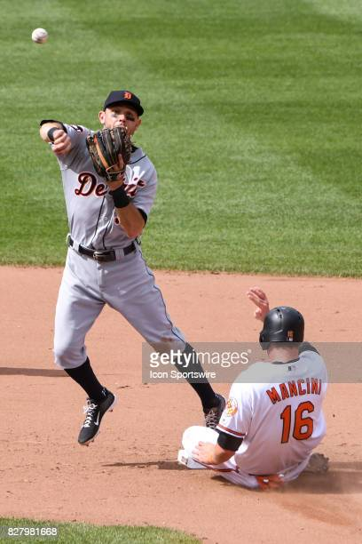 Detroit Tigers second baseman Ian Kinsler fails to complete a double play as Baltimore Orioles designated hitter Trey Mancini is forced out at second...