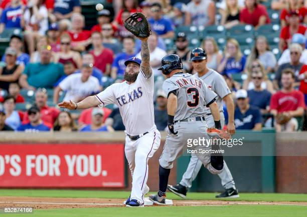 Detroit Tigers second baseman Ian Kinsler is safe at first baseman as Rangers Mike Napoli tries to make the play during the MLB game between the...