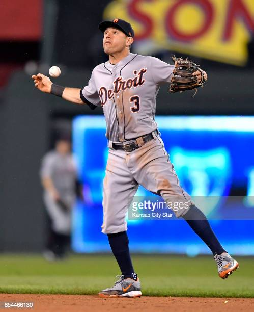 Detroit Tigers second baseman Ian Kinsler loses the ball on a grounder for a single by the Kansas City Royals' Lorenzo Cain in the eighth inning at...