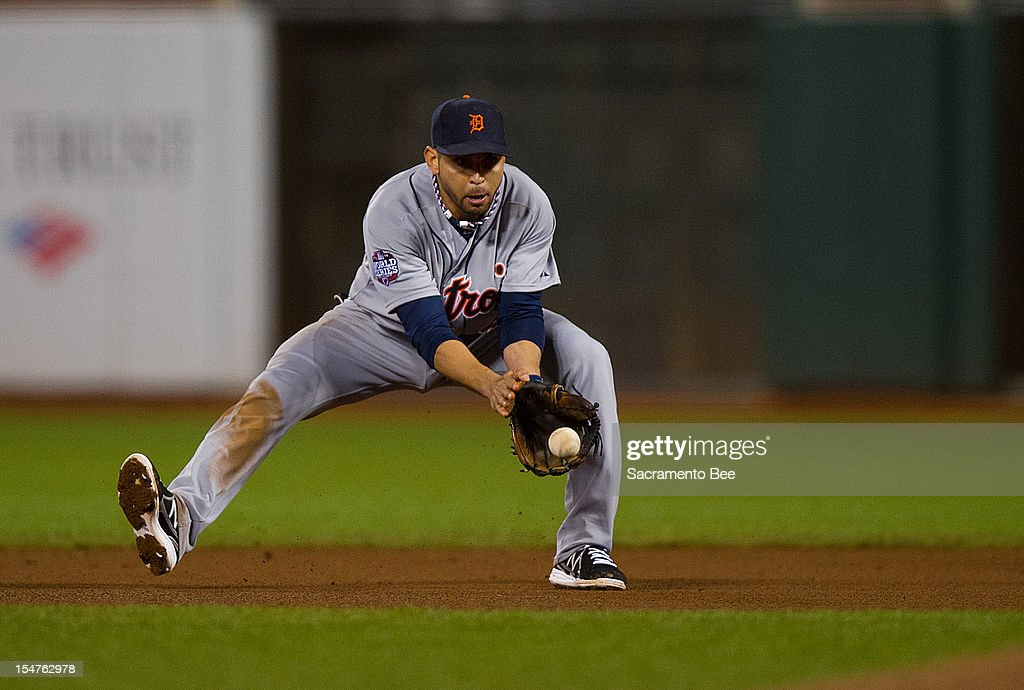 Detroit Tigers second baseman Omar Infante picks up a grounder off the bat of the San Francisco Giants' Brandon Crawford to start a double play in the seventh inning in Game 2 of the 2012 World Series at AT&T Park on Thursday, October 25, 2012, in San Francisco, California.