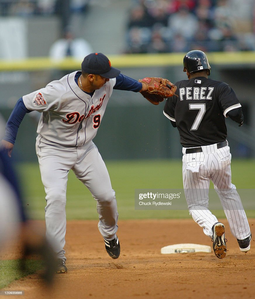 Detroit Tigers Shortstop, Carlos Guillen, misses the tag of Timo Perez during the game against the Chicago White Sox April 30, 2005 at U.S. Cellular Field in Chicago, Illinois. The White Sox would win 4-3.