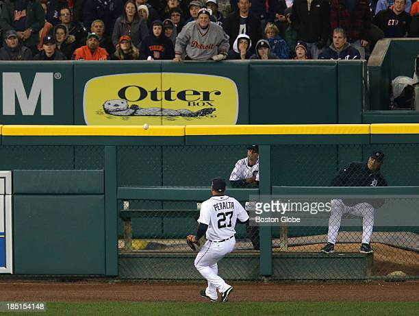 Detroit Tigers shortstop Jose Iglesias makes a highlight over the shoulder basket catch of a fly to short center field by Boston Red Sox designated...