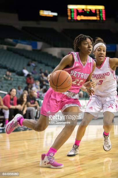 Detroit Titans G/F Zoey Oatis is defende by Cleveland State Vikings G Chrishna Butler during the fourth quarter of the women's college basketball...