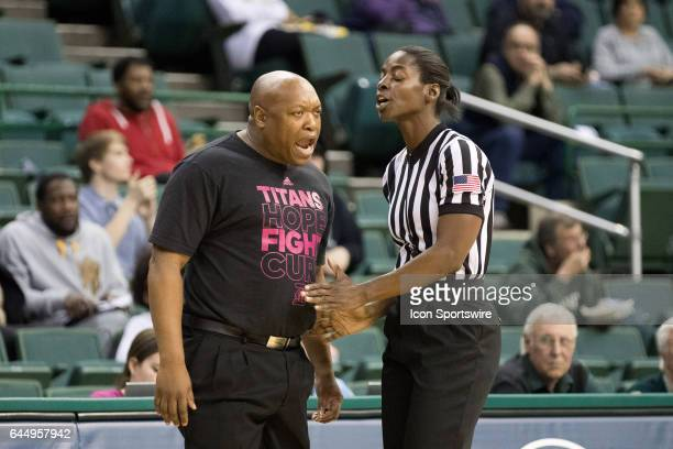 Detroit Titans head coach Bernard Scott argues with an official over a call during the third quarter of the women's college basketball game between...