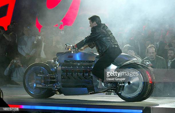 Detroit Wolfgang Bernhard Chief Operating Officer Chrysler Group tries out the 2003 Dodge Tomahawk Concept Bike at the North American International...