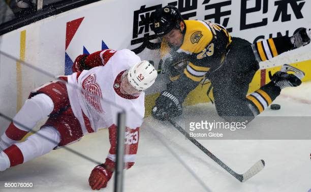 Detroit's Dennis Cholowski left and the Bruins' Jakob Forsbacka Karlsson right both hit the corner ice in the second period The Boston Bruins host...
