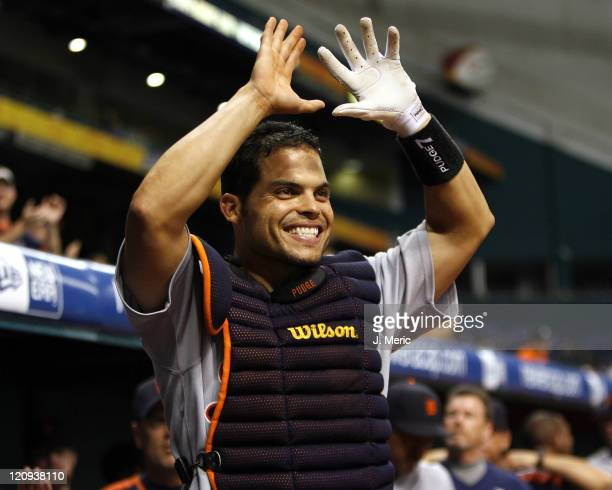 Detroit's Ivan Rodriguez awaits his teammate after a homer during Tuesday night's action against Tampa Bay at Tropicana Field in St Petersburg...