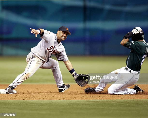 Detroit's Placido Polanco tries to get the throw as Tampa Bay's Julio Lugo successfully steals second base in Thursday night's game at Tropicana...