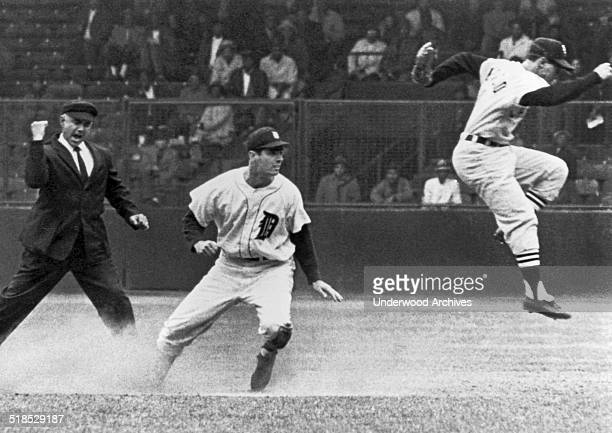 Detroit's Rocky Colavito is called out at second by umpire Sam Carrigan as Chicago White Sox shortstop Luis Aparicio leaps out of the way after...