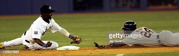 Detroit's Rondell White was safe at 2nd with a double despite the efforts of Toronto's Orlando Hudson in MLB action at the Rogers Centre in Toronto...