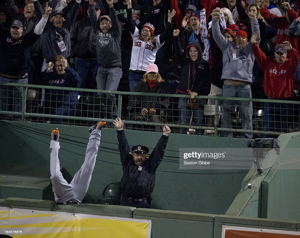 Detroit's Torii Hunter falls into the bullpen trying to catch Red Sox designated hitter David Ortiz's home run that tied the game in the eighth inning. The Boston Red Sox hosted the Detroit Tigers in Game Two of the American League Championship Series at Fenway Park.