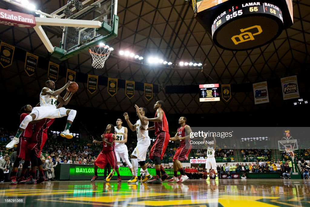 Deuce Bello #14 of the Baylor University Bears drives to the basket against the Lamar Cardinals on December 12, 2012 at the Ferrell Center in Waco, Texas.