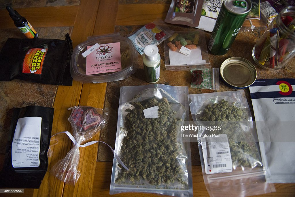 Deuel County Sheriff Adam Hayward shows off a selection of confiscated marijuana items used to education eachers about the clever packaging of the product in Chappell, Nebraska, on Tuesday, July 1, 2014.