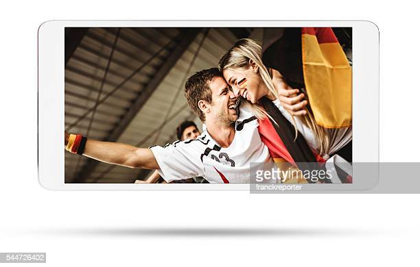 deutsch supporter at the stadium on the tablet