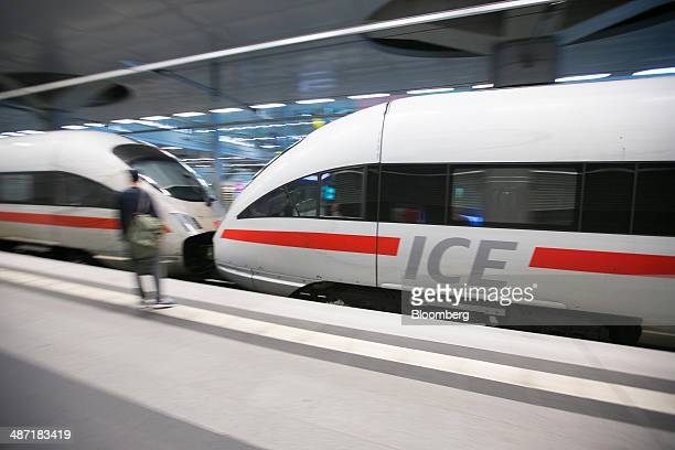 A Deutsche Bahn AG InterCity Express train manufactured by Siemens AG arrives at Berlin Central Station in Berlin Germany on Monday April 28 2014...