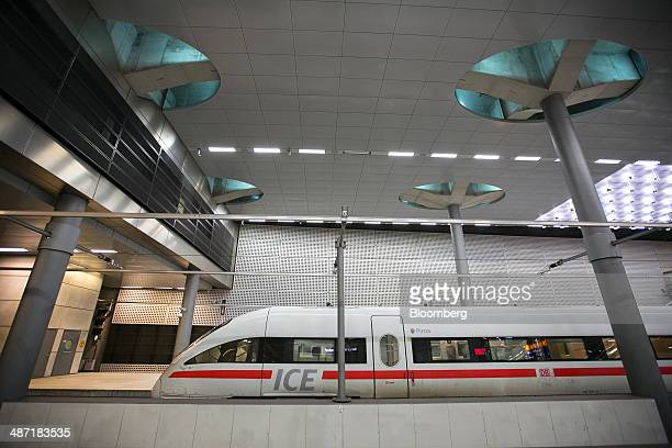 A Deutsche Bahn AG InterCity Express train manufactured by Siemens AG sits on a platform at Berlin Central Station in Berlin Germany on Monday April...