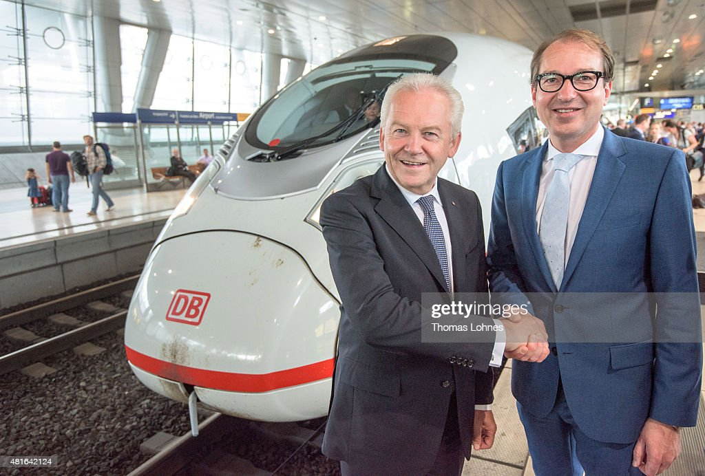 Deutsche Bahn CEO Ruediger Grube and Transport and Digital Technologie Mininister Alexaner Dobrindt (CSU, R) shake hands in front of the new ICE on July 23, 2015 in Frankfurt am Main, Germany. The new ICE 3 in the Franco-German high-speed rail has been officially launched with a trip from Frankfurt to Paris.