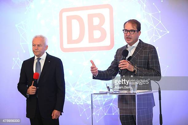 Deutsche Bahn Chief Executive Ruediger Grube and German Transport and Digital Technologies Minister Alexander Dobrindt attend a press conference...