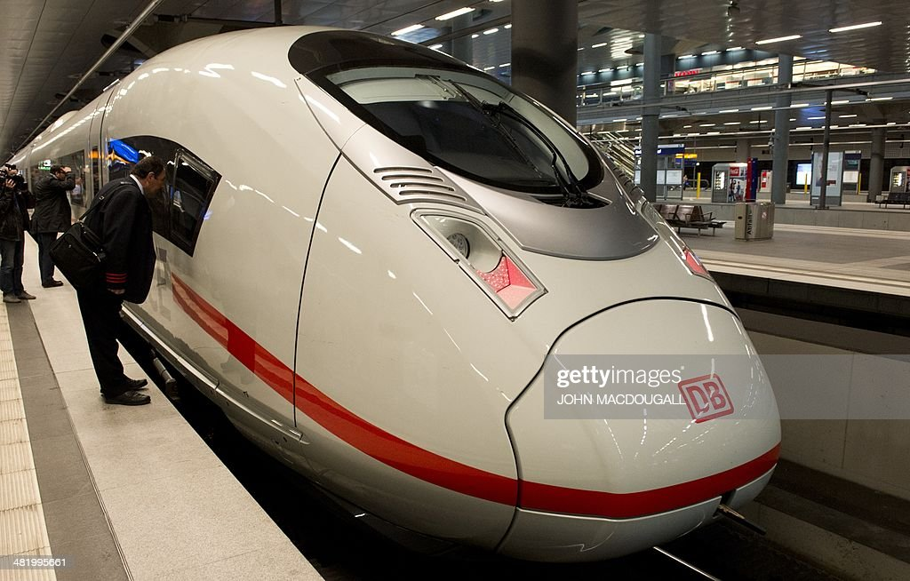 A Deutsche Bahn (DB) conductor looks into the engine of a Siemens InterCity Express (ICE) 3 train during a presentation of the last of 8 new ICE 3 trains recently delivered to DB, at Berlin's main railway station April 2, 2014.
