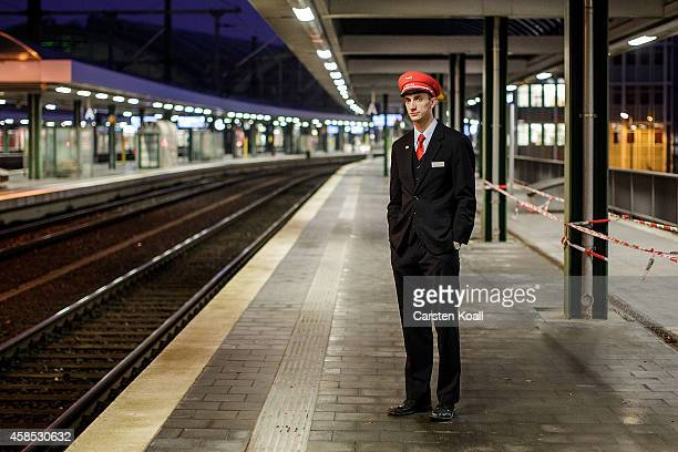 Deutsche Bahn employee stands on a platform at Ostbahnhof railway station during a fourday strike by the GDL train drivers labor union on November 6...
