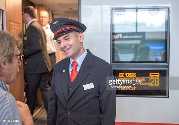 Deutsche Bahn train attendant talks to a guest in front of the new ICE 3 train on July 23 2015 in Frankfurt am Main Germany