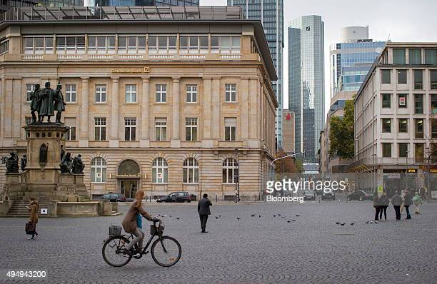A Deutsche Bank AG branch sits as the Deutsche Bank AG stand in the distance in Frankfurt Germany on Thursday Oct 29 2015 Deutsche Bank AG said it...