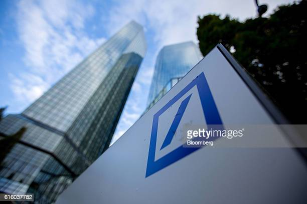 A Deutsche Bank AG logo sits on a sign outside the German lender's twin tower skyscraper headquarter offices in Frankfurt Germany on Thursday Oct 20...