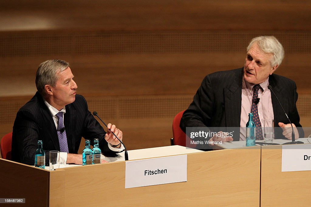 Deutsche Bank co-Chairman <a gi-track='captionPersonalityLinkClicked' href=/galleries/search?phrase=Juergen+Fitschen&family=editorial&specificpeople=3093173 ng-click='$event.stopPropagation()'>Juergen Fitschen</a> and Josef Joffe, editor in chief of German weekly 'Die Zeit' attend a podium discussion at the Ruhr Initiative Circle (Initiativkreis Ruhr) congress on December 17, 2012 in Essen, Germany. German police recently raided the headquarters of Deutsche Bank and are investigating Fitschen and 24 other Deutsche Bank employees on suspicion of money laundering and tax evasion related to the trading of carbon emissions certificates.