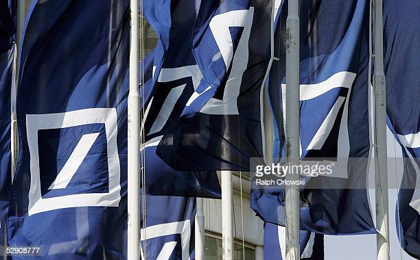 Deutsche Bank flaggs are blown in the wind during the banks annual shareholders meeting on May 18 2005 in Frankfurt Germany Deutsche Bank will go...
