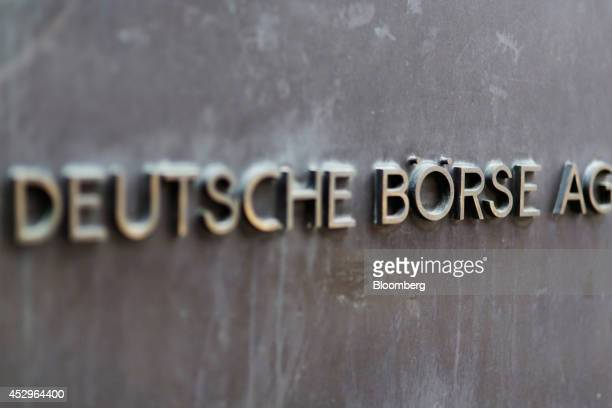 A Deutsche Borse AG plaque sits outside the Frankfurt Stock Exchange in Frankfurt Germany on Wednesday July 30 2014 The US is considering further...