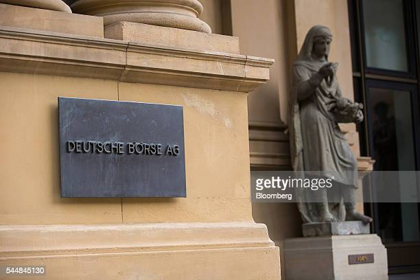 A Deutsche Borse AG plaque sits outside the Frankfurt Stock Exchange in Frankfurt Germany on Monday July 4 2016 Equities are halting a rebound after...