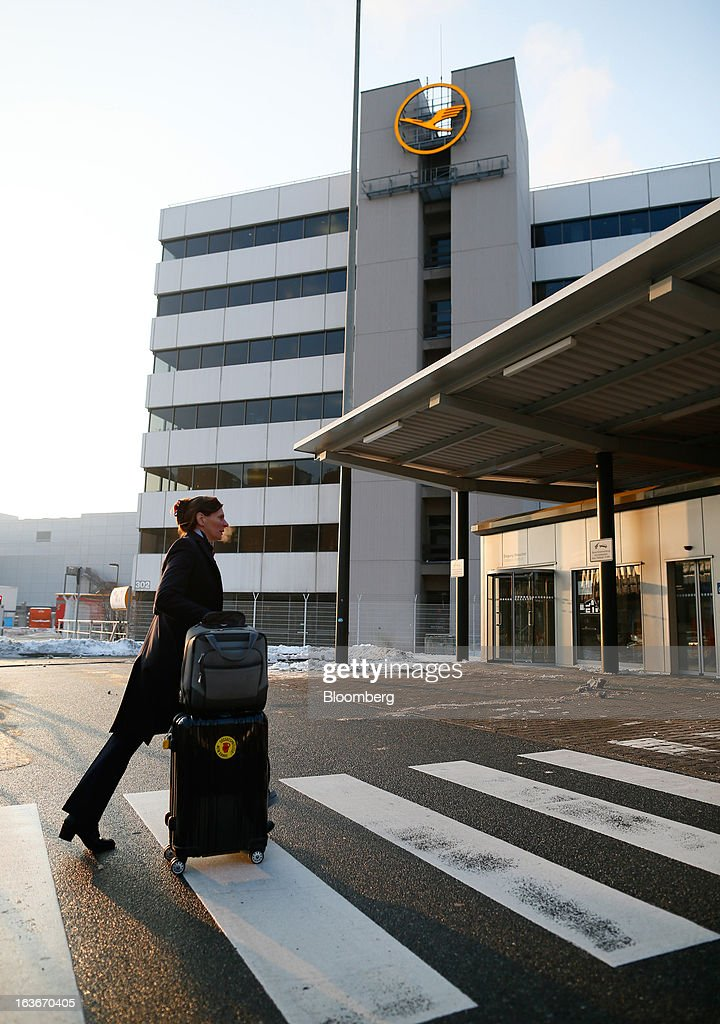 A Deutsche Lufthansa AG employee crosses a pedestrian crossing outside Frankfurt airport in Frankfurt, Germany, on Thursday, March 14, 2013. Deutsche Lufthansa AG agreed to renew its short-haul fleet with 100 mostly fuel-efficient jets from Airbus SAS, as the airline seeks to cut kerosene costs that constitute its single biggest expense. Photographer: Ralph Orlowski/Bloomberg via Getty Images