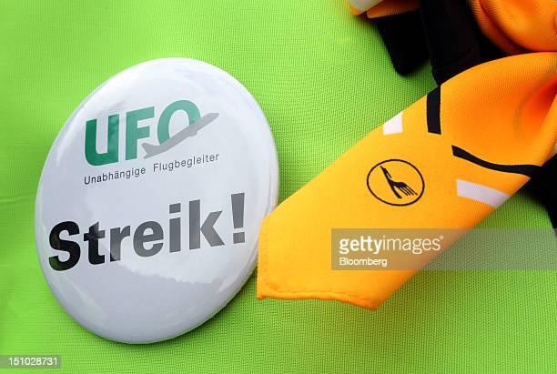 A Deutsche Lufthansa AG employee wears a 'Strike' badge during a protest at Frankfurt's RheinMain airport in Frankfurt Germany on Friday August 31...