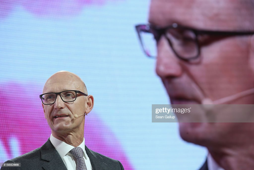 Deutsche Telekom CEO Timotheus Hoettges speaks in front of a monitor showing his live broadcast at the Deutsche Telekom stand at the 2016 CeBIT...