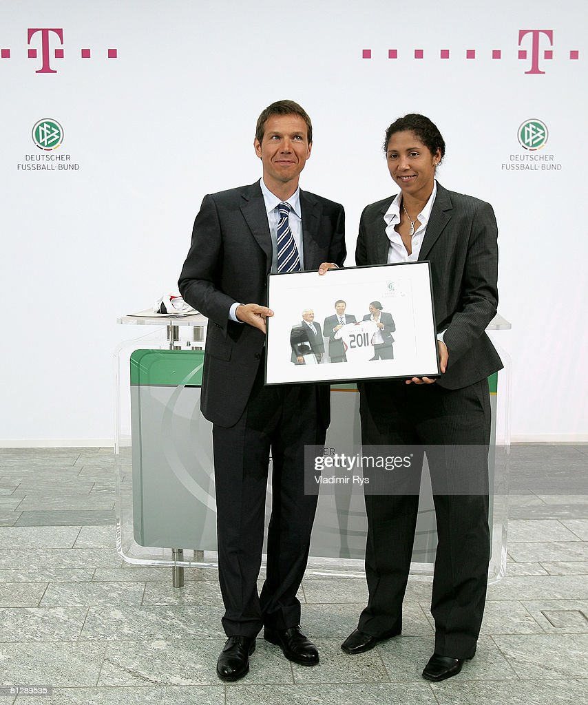 Deutsche Telekom Chairman Rene Obermann and President of the FIFA 2011 Women's World Cup Organising Commitee Steffi Jones pose for a photo during...